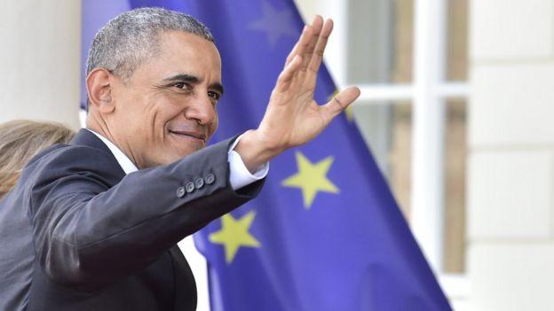 US President Barack Obama waves upon arrival in Hanover, Germany, 24 Apr 16