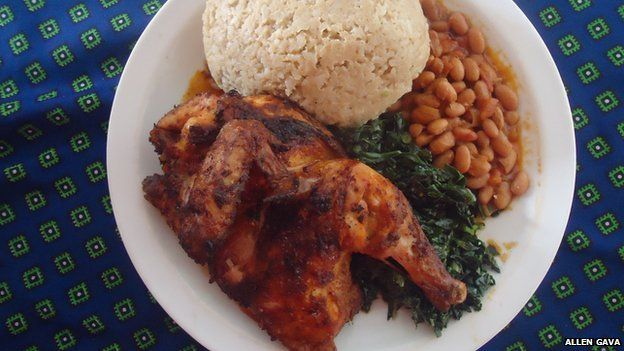 A meal from Gava's Restaurant, chicken, beans, sadza, and green vegetables