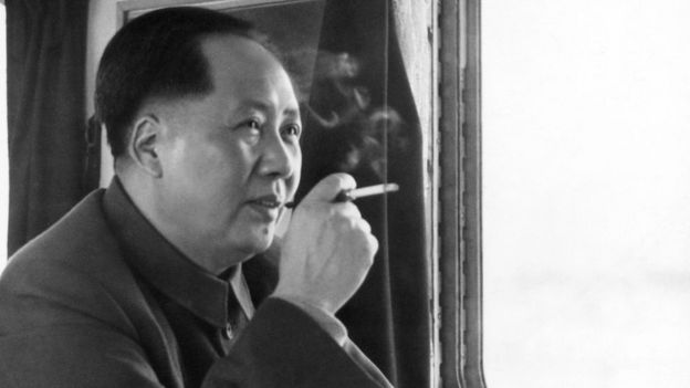 Mao Zedong smoking a cigarette