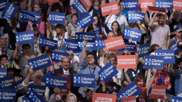 Delegates hold posters as Vice presidential nominee Tim Kaine addressed the Democratic convention.