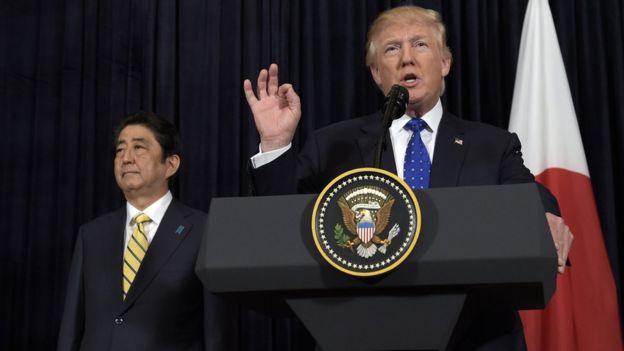 US President Donald Trump speaks alongside Japanese Prime Minister Shinzo Abe following North Korea's missile launch on Sunday, 11 February 2017