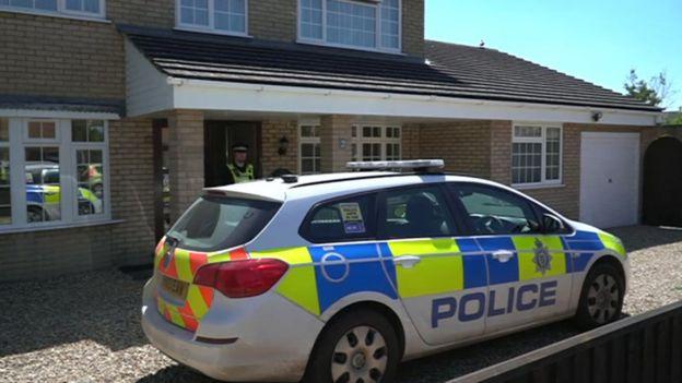 Police car outside house