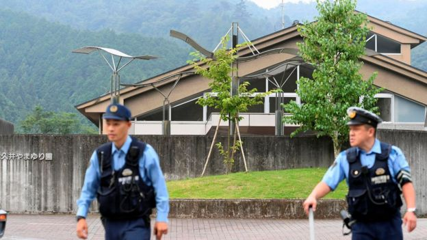Police officers stand in front of the Tsukui Yamayuri Garden facility for disabled people in Sagamihara, Japan