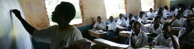 A teacher writes on a blackboard during a class at the Bar Sauri elementary school in eastern Kenya 22 March 2007