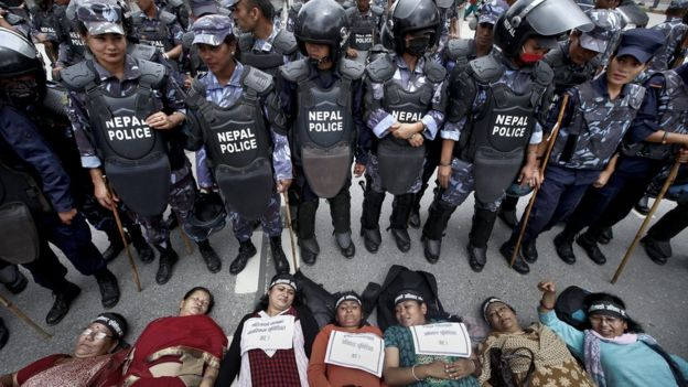 Nepalese women activists lie down on a road during a protest demanding women rights in upcoming constitution in Kathmandu, Nepal, 07 August 2015
