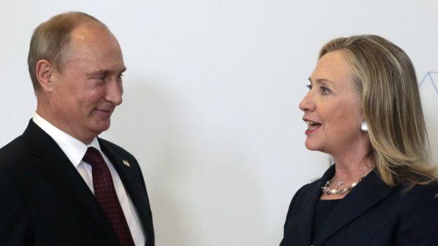 Vladimir Putin y Hillary Clinton