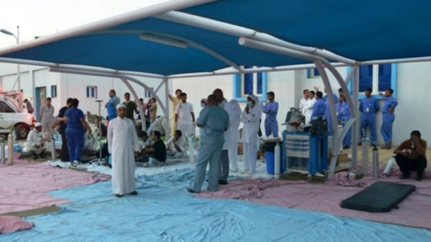 Medics gather outside a hospital in Saudi Arabia after a fire