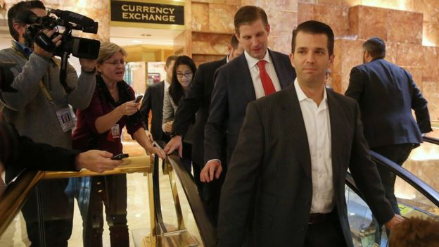 Sons Eric Trump (L) and Donald Trump Jr go down escalators outside offices of Republican president-elect Donald Trump at Trump Tower in New York, New York, U.S. November 14, 2016