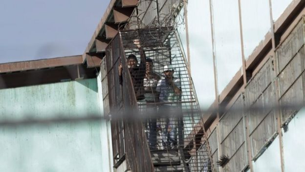 Inmates look from a staircase at the Topo Chico prison in Monterrey, Mexico on 11 February, 2016