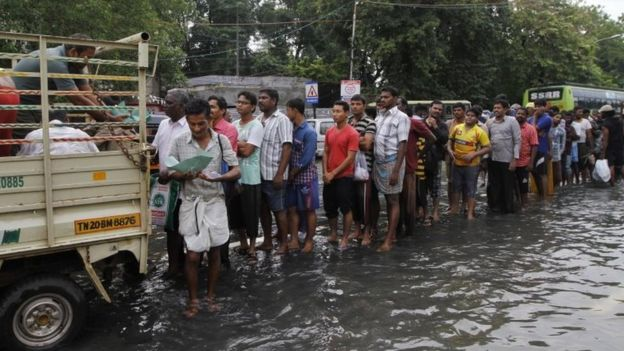 Flood affected people queue up for food in Chennai, India, Thursday, Dec. 3, 2015