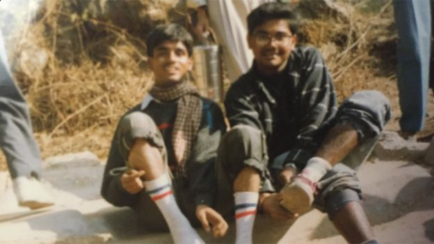 Ambarish Mitra (right) with a friend when he lived in a slum