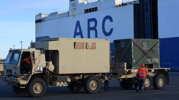 US Military vehicles are unloaded from a carrier ship in the harbour in Bremerhaven