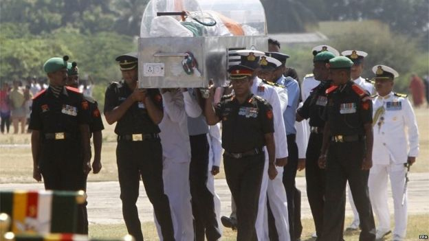 Indian officials carry the coffin containing the remains of Indian former president A. P. J. Abdul Kalam at ramanathapuram, mantapam camp around 640km from southern Indian city of Chennai, on 29 July 2015