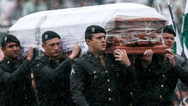 A coffin of a victim of the Chapecoense plane crash being carried into the stadium