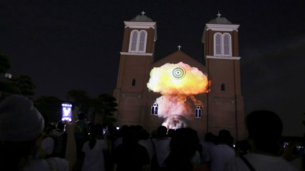 An image of a mushroom cloud is projected on to the Urakami Cathedral on the eve of the bombing's anniversary - 8 August 2015