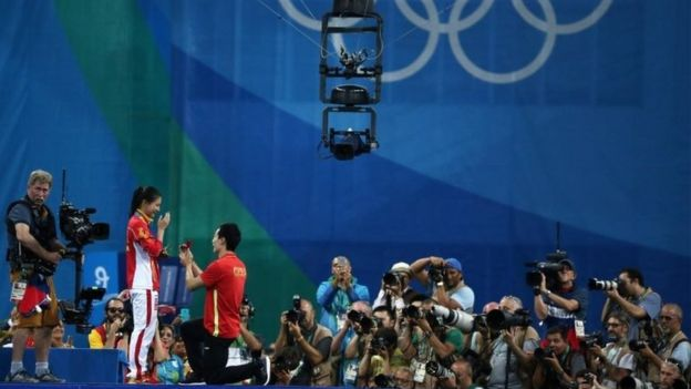He Zi (CHN) of China recieves a marriage proposal from Olympic diver Qin Kai (CHN) of China after the medal ceremony
