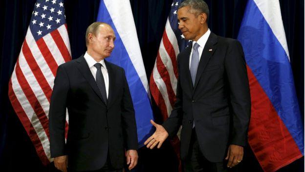 O presidente da Rússia, Vladimir Putin, com o presidente dos Estados Unidos, Barack Obama