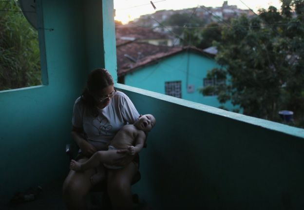 Woman in Recife, Brazil holding a child who was born with microcephaly