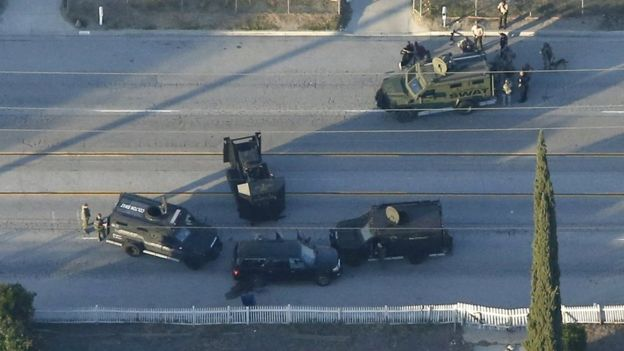 An SUV with its windows shot out that police suspect was the getaway vehicle from at the scene of a shooting in San Bernardino, California is shown in this aerial photo December 2, 201