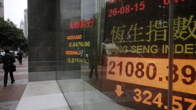 An electronic board showing Hong Kong share index outside a local bank in Hong Kong