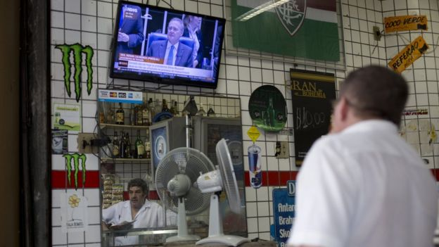 Man watches Senate session on whether to impeach President Dilma Rousseff, at a local bar in Rio de Janeiro, Brazil,