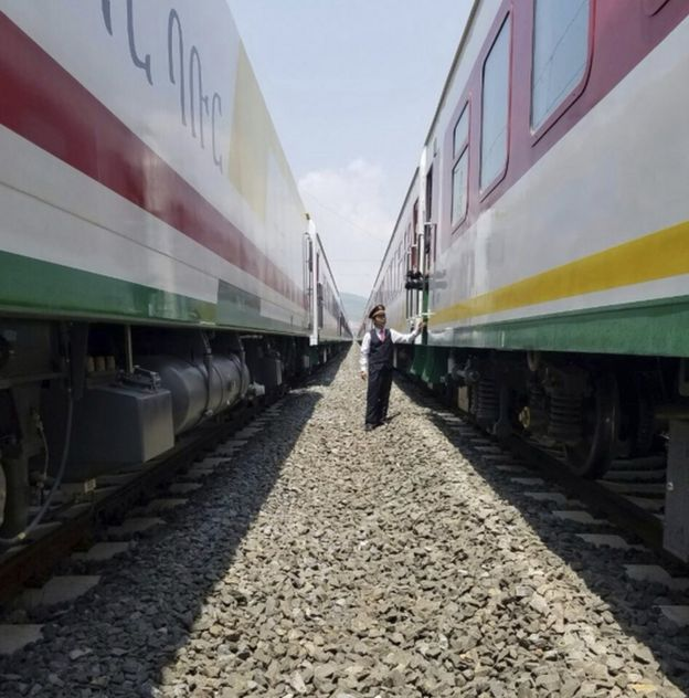 Chinese Chinese attendant inspects as reporters board the new Addis Ababa to Djibouti railway system