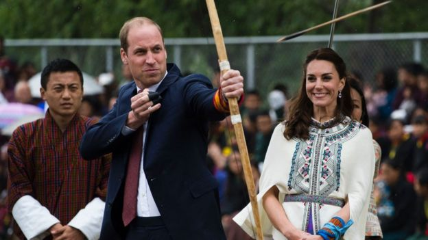 Prince William firing an arrow