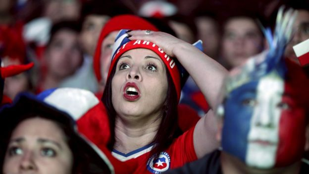 Fans of Chile react while watching a broadcast of the Copa America semi-final soccer match between Chile and Peru at the Fan Fest in Santiago, Chile June 29, 2015.