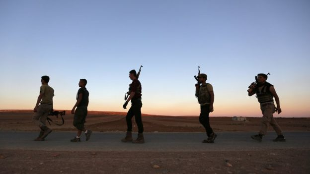 Rebel fighters carry their weapons in northern Aleppo countryside, Syria September 30, 2016.