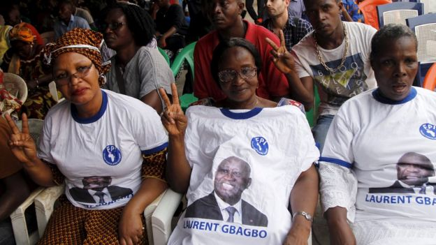Supporters of former Ivory Coast President Laurent Gbagbo watch his trial in Abidjan