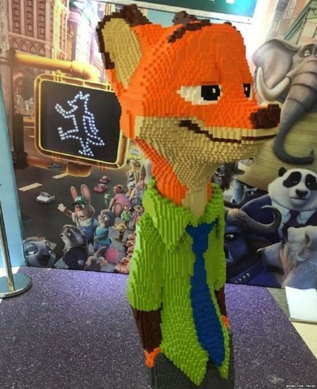 Photo of statue of Nick from the film Zootopia made out of LEGO.