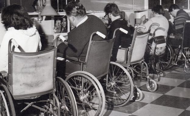 five wheelchair users working