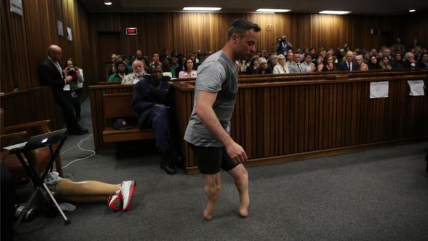 Oscar Pistorius walks across the courtroom without his prosthetic legs during the third day of Oscar's hearing for a resentence at Pretoria High Court on June 15, 2016 in Pretoria, South Africa.
