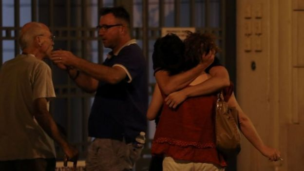 People react in Nice after the lorry hit crowds