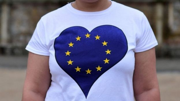 A non-British EU citizen, unable to vote in the EU referendum, poses wearing an EU-flag themed t-shirt