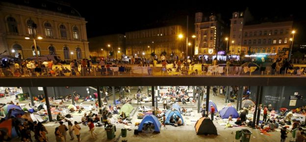 Migrants are seen at a makeshift camp in an underground station in front of the Keleti railway station in Budapest, Hungary, September 3, 2015.