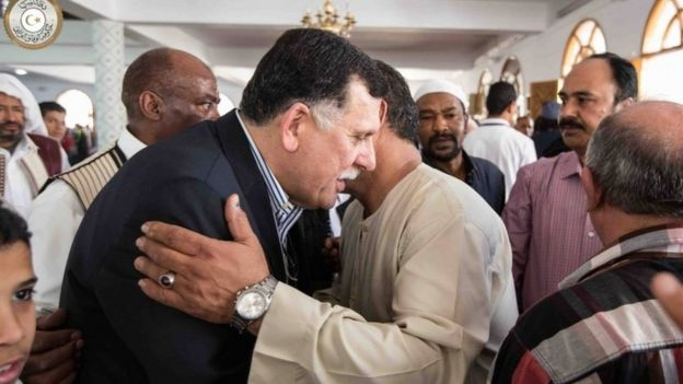 Fayez al-Sarraj being greeted at a mosque in Tripoli