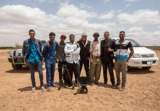Group picture in the desert - Omar Hassan, Mohamed Saleh, Adam Konvict, Ibrahim Mohamed, Hersi Abdirizak, Saeed Abdi, Abdiaziz Mohamed and Mohammed Shire