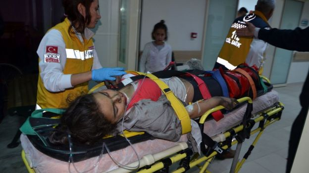 Injured girl is taken to hospital following a fire at a dormitory in Adana, southern Turkey, on November 29, 2016