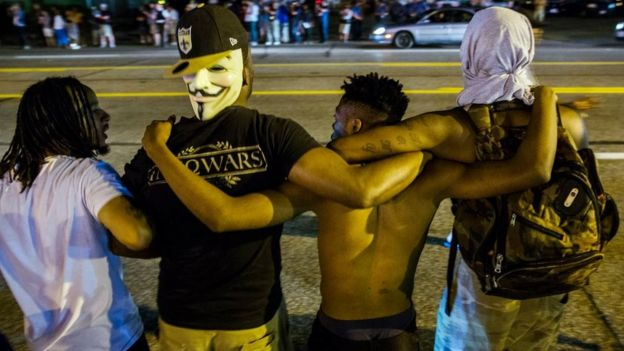Protesters chant during demonstration in Ferguson, Missouri, on 11 August 2015