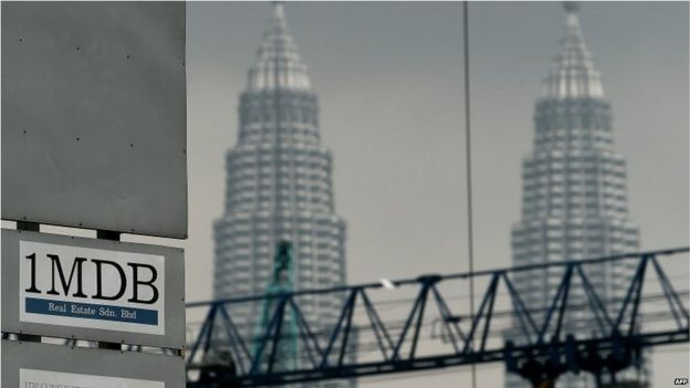 The 1 Malaysia Development Berhad (1MDB) logo is seen on a billboard at the funds flagship Tun Razak Exchange under-development site in Kuala Lumpur on 3 July 2015