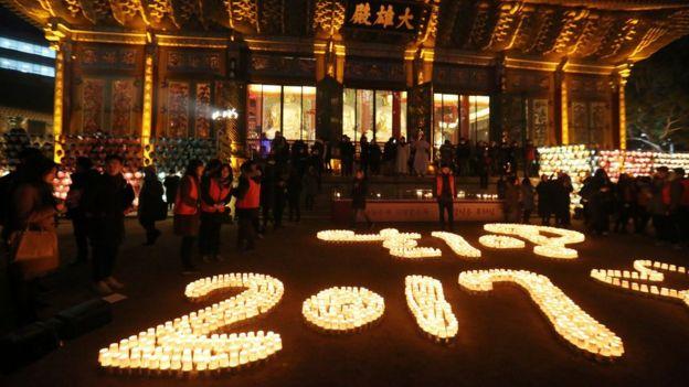 Buddhists light