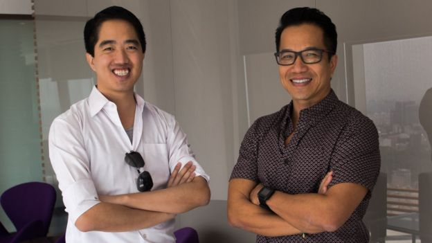 Eddie Thai (left) and Binh Tran standing with arms crossed