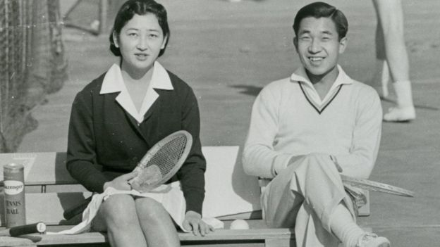 Crown Prince Akihito and Michiko Shoda enjoy tennis at Tokyo Lawn Tennis Club on December 6, 1958 in Tokyo, Japan