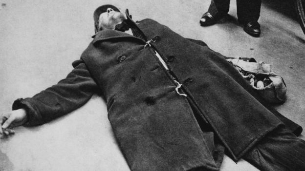 A man collapsed on the street from starvation during the Dutch famine of the winter of 1944-45, Netherlands, circa 1945.