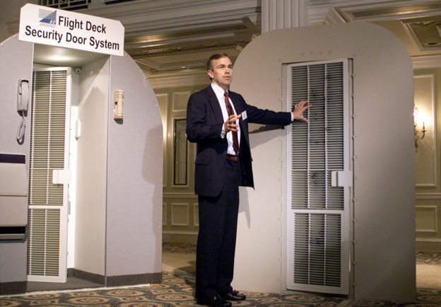 Scott Smith of B/E Aerospace Inc. shows the new AeroGuard cockpit security system featuring an anti-ballistic cockpit door with a patent-pending locking system that survives against handguns, automatic weapons and brute force assault October 29, 2001 in Washington, DC