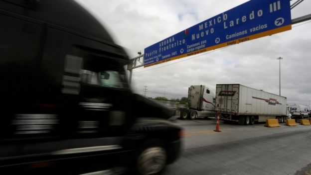 Trucks cross the US-Mexico border in Nuevo Laredo