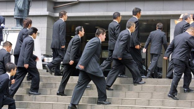 Members of of Japan's largest organised crime syndicate, the Yamaguchi-gumi, outside a court in Osaka