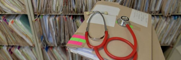 A stethoscope and a medical file