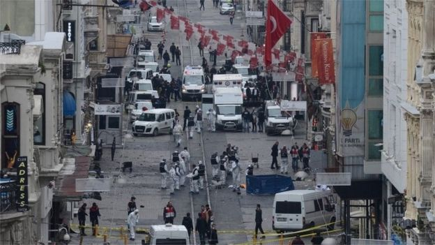 Turkish police, forensics and emergency services, work at the blast scene.
